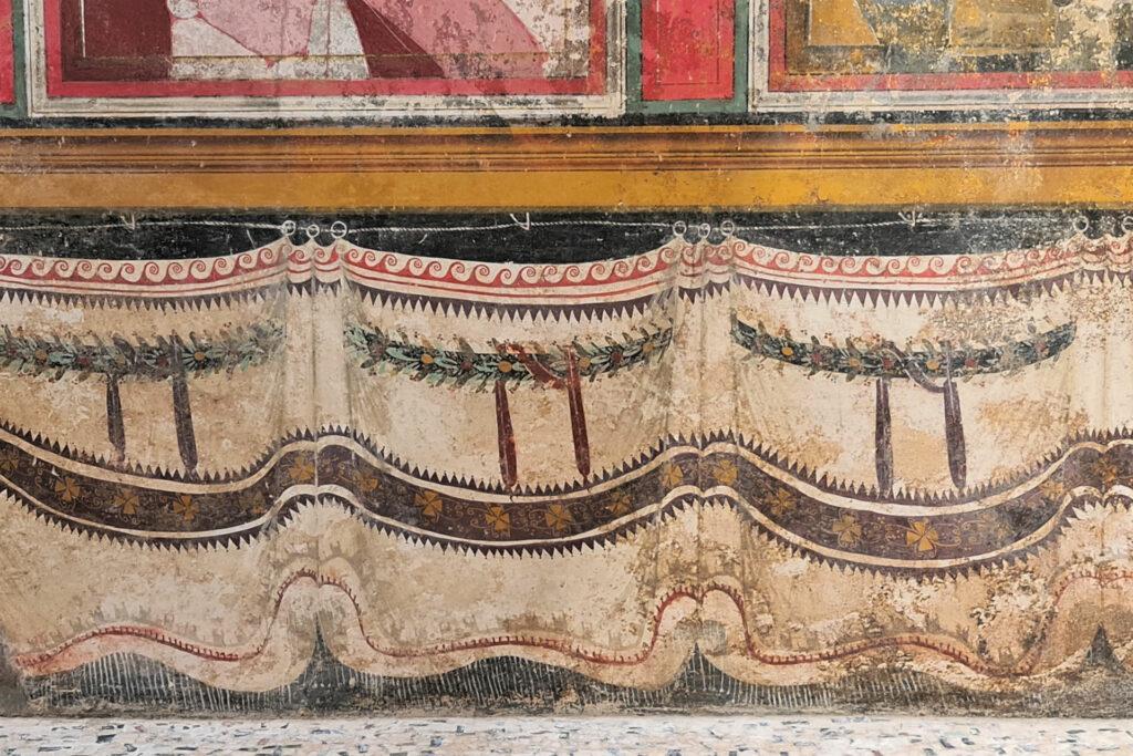 Particolare del velarium affrescato nel tempio tardorepubblicano
