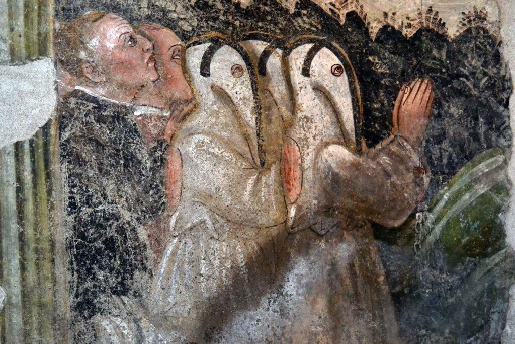 Particolare di un affresco con flagellanti nella chiesa di S. Giorgio a Cislano