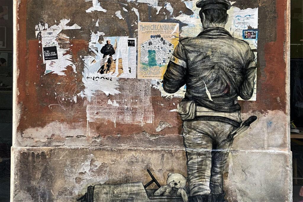 Paste up su un muro del quartiere del Carmine a Brescia